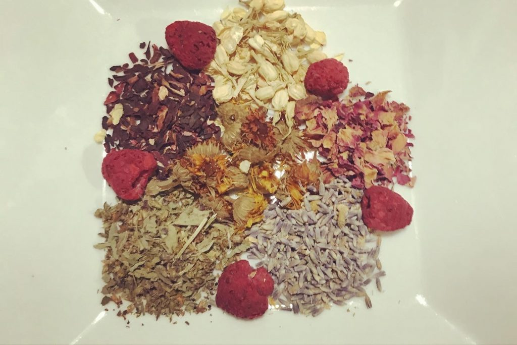 Facial tea blend with raspberries, lavender, rose petals, calendula, holy basil, hibiscus, and jasmine.