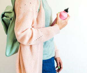 young woman with a backpack and a pink water bottle