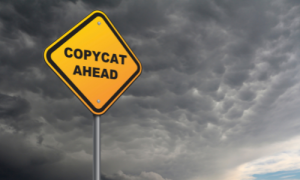 """Yellow sign that says """"copycat ahead"""""""
